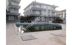 REMAX dan KARASU da havuzlu sitede kombili KİRALIK 2+1 daire