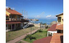 Hakan Emlaktan denize sıfır kiralık villa