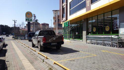 Altınıvada file market yanında daire karşılığı arsa