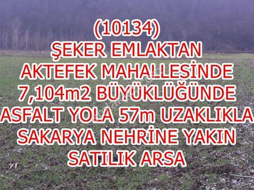 134-ŞEKER EMLAKTAN 7 104m2 YOLU VE SUYU OLAN SATILIK BAHÇE