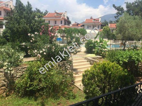 Fethiye Hisarönü'de bahçe katı 2+1 havuzlu site de