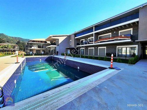 Marmaris merkezde ortak yüzme havuzlu 3+1 sıfır dubleks satılık