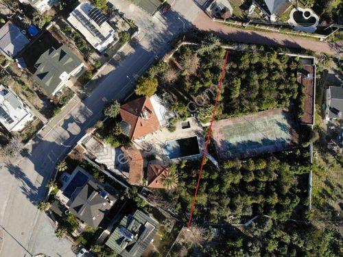 Kemer Tekirova bölgesinde 2.258 m2 satılık arsa ve müstakil villa